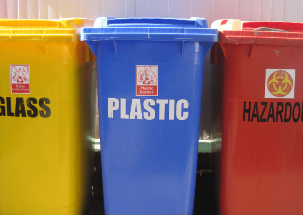 separate bins for waste glass bottles recycling